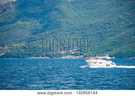 MONTENEGRO BOKA-KOTOR BAY - MAY 27/2017: happy tourists sunbathe on a pleasure boat.