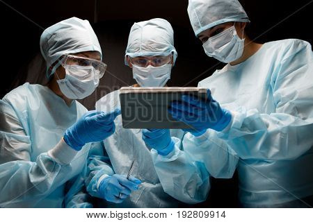 Doctors with tablet in hands