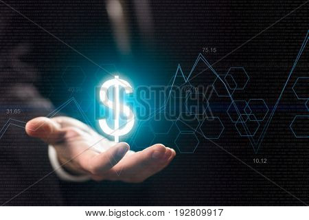 Currency symbols on human hand. Money making and wealth