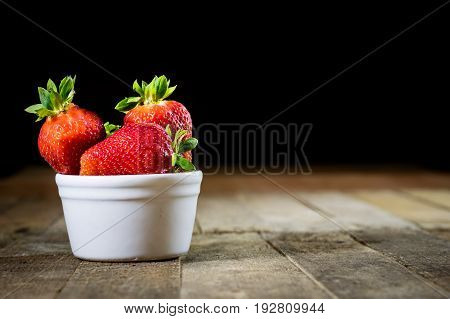 Delicious Strawberries In A Homemade Kitchen On A Wooden Table