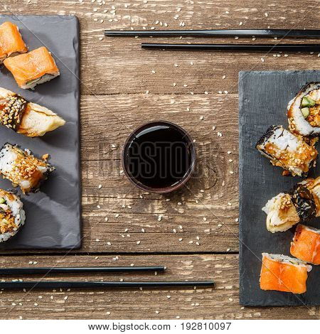Japanese seafood sushi , rolls and chopstick for two plates
