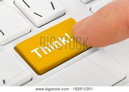 Computer notebook keyboard with Think key - technology background
