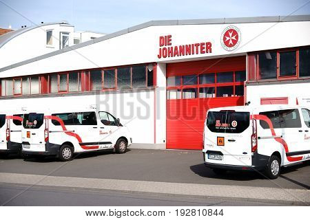 MAINZ, GERMANY - MAY 27: Emergency vehicles of the rescue service Johanniter Ambulance parked outside a garage on May 27, 2017 Mainz.