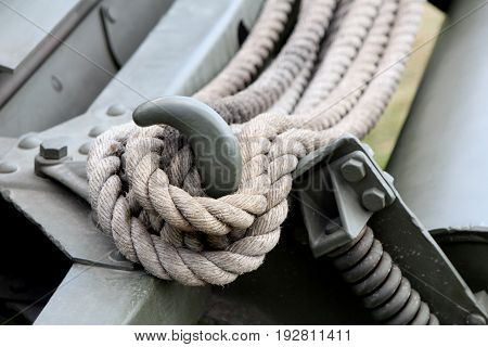 Close Up Of Rope Looped Around A Hook On A Military Army Vehicle