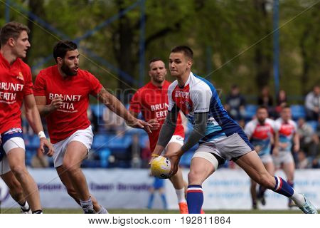 ST. PETERSBURG, RUSSIA - MAY 27, 2017: Match Mediterranee XV, France (red shirts) vs youth team of St. Petersburg during Rugby Europe Sevens Club Champion's Trophy