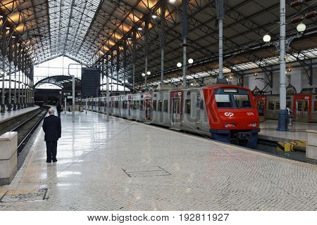 LISBON, PORTUGAL - MAY 9, 2017: People on the platform of the Rossio train station. Former central railway station, it was opened in 1891 and connected the city with the region of Sintra