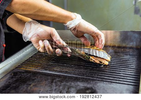 cooking fish Steak close-up. salmon roasted close up on home electronic grill plate tasty diet fish meal.