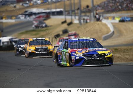 June 25, 2017 - Sonoma, CA, USA: Kyle Busch (18) battles for position during the Toyota/Save Mart 350 at Sonoma Raceway in Sonoma, CA.
