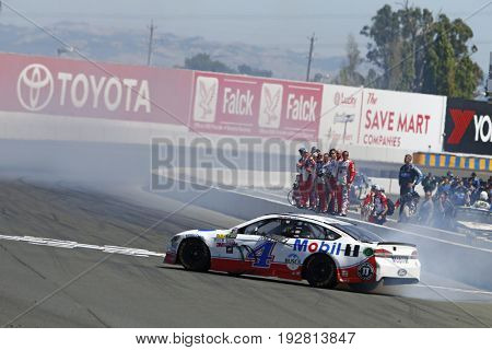 June 25, 2017 - Sonoma, CA, USA: Kevin Harvick (4) does a burnout in front of his crew after he wins the Toyota/Save Mart 350 at Sonoma Raceway in Sonoma, CA.