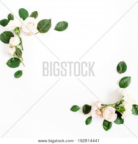 Border frame with beige rose flower buds and green leaves isolated on white background. Flat lay top view. Floral background