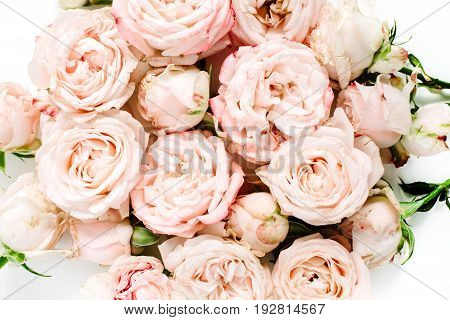 Beige rose buds bouquet on white background. Flat lay top view.