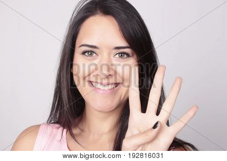 Young Woman Counting Four With Her Fingers.