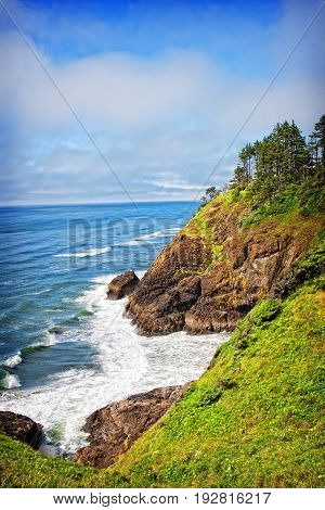 A coastal view from the spot of the North Head Lighthouse in Cape Disappointment State Park in Washington USA. The North Head lighthouse was built to compliment the nearby Cape Disappointment lighthouse.