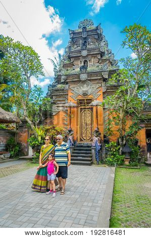 BALI, INDONESIA - APRIL 05, 2017: Unidentified people posing in Puri Kantor a Hindu temple in the center of Ubud, Bali, Indonesia.