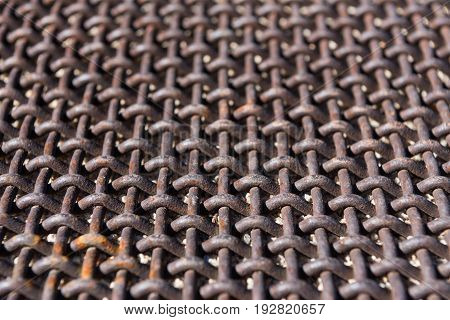Low Angle View of Mesh Grid rusted from exposure to weather