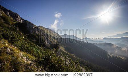High mountain ridge and foggy valley during sunrise, Koschuta, Slovenia