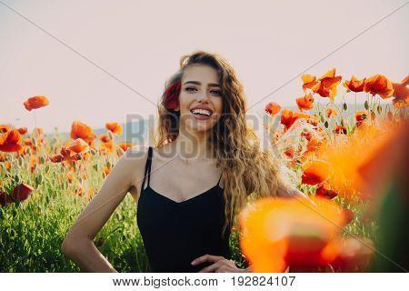 Woman In Field Of Poppy Seed