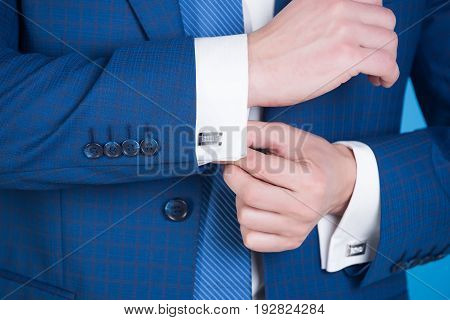 Hand Fixing Elegant Cufflink On White Shirt Cuff Sleeve