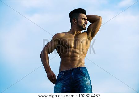 Muscular Man With Muscle Torso Sunny Day On Blue Sky