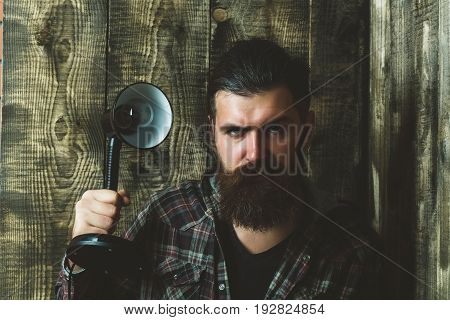 Man With Serious Face Holding Electric Lamp