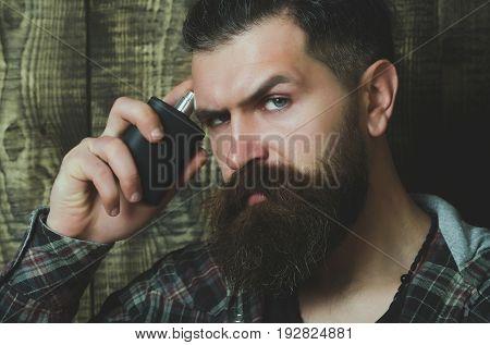 Bearded Man Holding Perfume Bottle