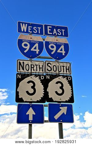 Highway road traffic signs include the I-94 Interstate and North Dakota state highway number three with an outline of an Indian Chief