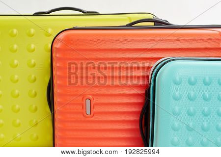 Big colorful suitcases macro. Personal objects for travel abroad.