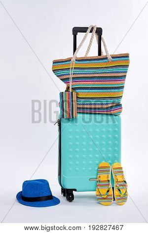Beach accessories and wheeled suitcase. Trip for seaside.