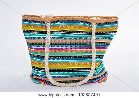 Handbag for beach isolated on white. Colorful woman textile handbag, white background.