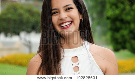 Young Teen Girl And Laughter Wearing a White Top