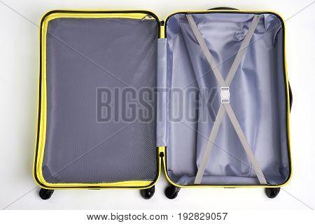 Opened empty traveler suitcase. Large bag for travelling, white background.