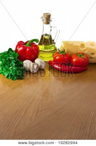 Empty table with ingredients  and space for your salad or pizza