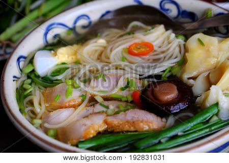 Homemade Vietnam food egg noodle soup with wontons colorful food ingredient for this eating as egg pork broth shallot bean sprout agaric vegetable poster