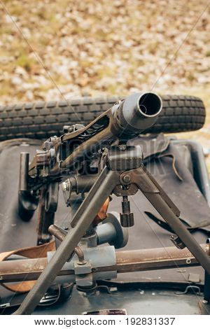 German machine gun of the times of World War II close-up mounted on the motorcycle's cradle