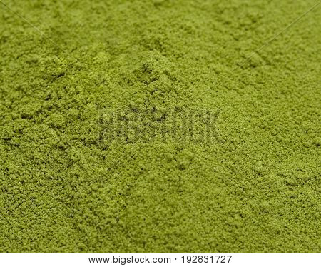 border of powdered green tea top view Background surface of green powder matcha tea
