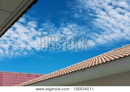 Roof tiles with blue sky and white clouds