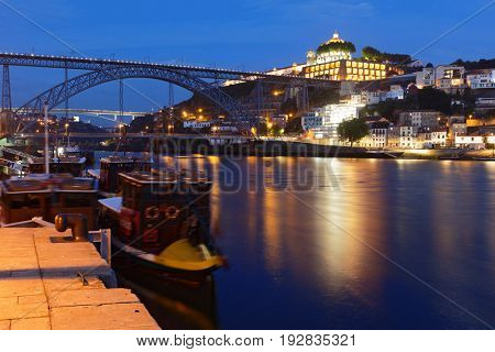 PORTO, PORTUGAL - MAY 8, 2017: Night view of the Dom Luis I Bridge across river Douro. This double-deck metal arch bridge was built in 1881-1886