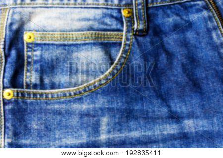 close up view of front pocket vintage blue denim jeans pant fashion texture background, soft focus