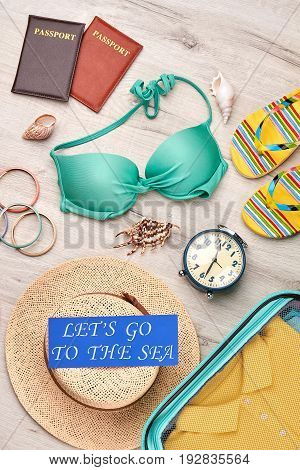 Collection of beach clothing, top view. Fashionable accessories for travelling abroad.