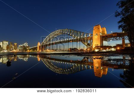 Sydney Harbour Bridged with reflection viewed from Milsons Point in North Sydney Australia. Sydney Harbour is a beautiful meandering waterway famous around the world.