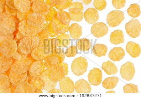 Corn flakes closeup pattern on white background top view. Cereals texture.