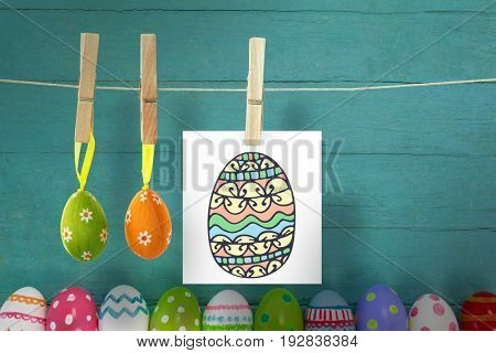 PE047_eggs_02_bs_nf against various easter eggs arranged on wooden surface