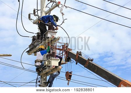 Technicians Installing  Instrument Transformers on Electrical Pole