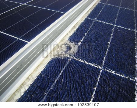 Solar Panels Broken by Falling Bullet near Frame
