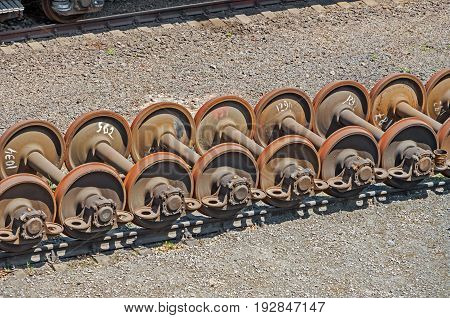 Rusty exhausted railroad wheelsets are on the sidetrack of the wagon depot