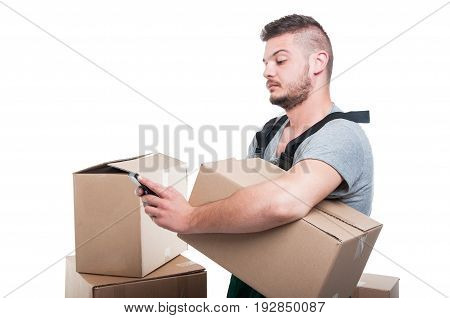 Mover Man Holding Cardboard Box And Texting Smartphone