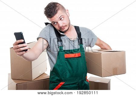 Mover Guy Holding Cardboard Box And Browsing Smartphone