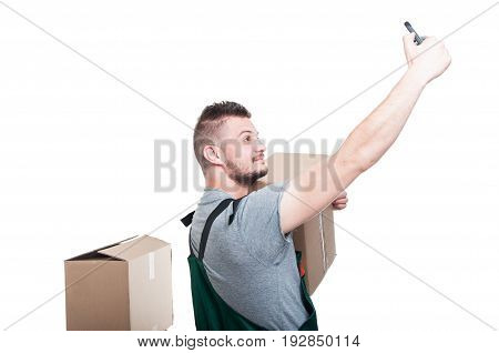 Side View Of Mover Guy Taking Selfie