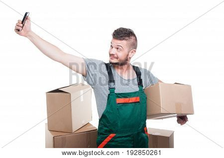 Mover Guy Holding Cardboard Box Taking Selfie