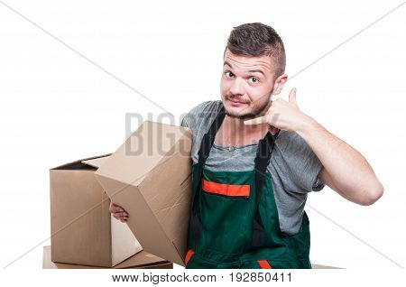 Mover Guy Holding Cardboard Box Making Call Me Gesture